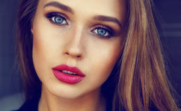Beauty portrait of sensual girl with evening makeup and red lips. Close-up beauty portrait of sensual girl with evening makeup and red lips Royalty Free Stock Image