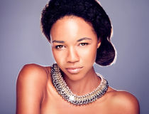 Beauty portrait of sensual woman. Beauty portraot of sensual african woman. Gilr looking at camera, wearing fashionable necklace Royalty Free Stock Image