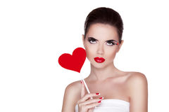 Beauty portrait of sexy cute girl with bright makeup holding red Stock Images