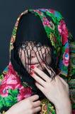 Beauty portrait of sexy model wearing scarf Stock Image