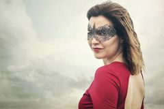 Woman in lace mask. Beauty portrait of mysterious woman in lace mask royalty free stock photos