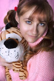 Beauty portrait of woman with soft toy Stock Images