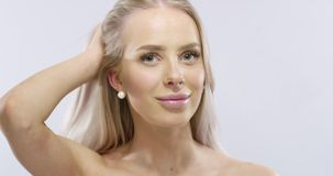 Beauty portrait of a smiling blonde woman in professional studio stock video