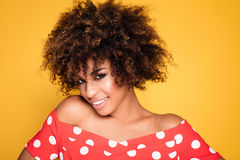 Beauty portrait of smiling girl with afro. Stock Photos