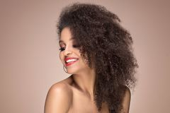 Beauty portrait of smiling sensual afro girl. Beauty portrait of young attractive african american woman with amazing toothy smile and glamour makeup Royalty Free Stock Photos