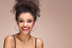Beauty portrait of smiling sensual afro girl. Beauty portrait of young attractive african american woman with amazing toothy smile and glamour makeup Royalty Free Stock Images