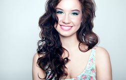 Beauty portrait of smiling young woman. Stock Photos