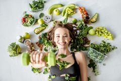 Portrait of a sports woman with healthy food royalty free stock photography