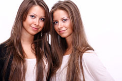 Beauty portrait of two beautiful young women Stock Photography