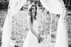 Black and white art monochrome photography. Beauty portrait of a very pretty young girl. Doll appearance. Woman with brown hair in a pink wedding dress on Royalty Free Stock Photos