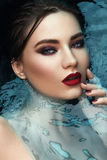 Beauty portrait in water, fashion vogue style shoot Royalty Free Stock Photos