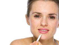 Beauty portrait of woman applying white eye liner Stock Photos