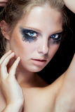 Beauty portrait of woman with black messed make up Stock Photos