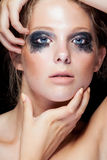 Beauty portrait of woman with black messed make up Royalty Free Stock Photography