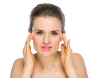 Beauty portrait of woman checking facial skin Royalty Free Stock Photo