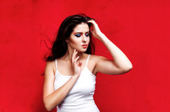 Beauty portrait of woman with colorful makeup on red backround Royalty Free Stock Images
