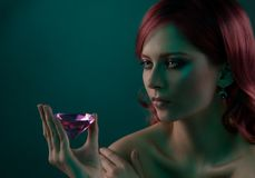 Beauty portrait of woman with diamond. Beauty portrait of woman with big pink diamond Royalty Free Stock Images