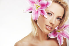 Beauty portrait of a woman with a flower Stock Photos