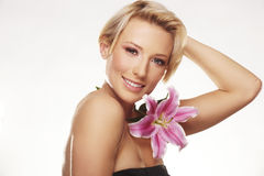 Beauty portrait of a woman with a flower Stock Photography