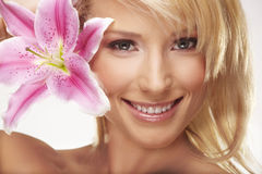 Beauty portrait of a woman with a flower Stock Images