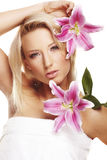 Beauty portrait of a woman with a flower Royalty Free Stock Photo