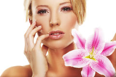 Beauty portrait of a woman with a flower Stock Image