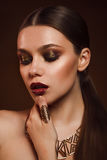 Beauty portrait of woman with gold makeup. Beauty portrait of girl with gold makeup Royalty Free Stock Photography