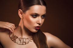 Beauty portrait of woman with gold makeup. Beauty portrait of girl with gold makeup Royalty Free Stock Images