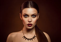 Beauty portrait of woman with gold makeup. Beauty portrait of girl with gold makeup Stock Image