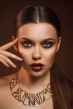 Beauty portrait of woman with gold makeup. Beauty portrait of girl with gold makeup Royalty Free Stock Image