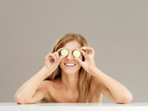 Beauty portrait woman holding cucumber slices Stock Images
