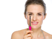 Beauty portrait of woman holding mascara brush Stock Photography