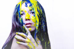 Beauty portrait of woman painted blue and yellow on white background Royalty Free Stock Image