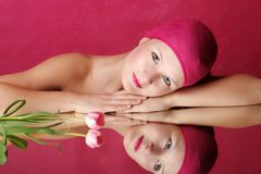 Beauty portrait of a woman in pink Royalty Free Stock Photo