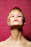 Beauty portrait of a woman in pink Royalty Free Stock Photos