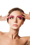 Beauty portrait of woman with pink feather lashes Stock Image