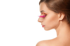 Beauty portrait of woman with pink feather lashes Stock Photos