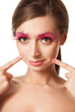 Beauty portrait of woman with pink feather lashes Stock Photography