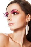 Beauty portrait of woman with pink feather lashes Stock Photo