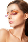 Beauty portrait of woman with pink feather lashes Stock Images