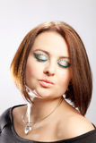 Beauty portrait of a woman. Woman with puckered lips and closed, striking painted, eyes royalty free stock images