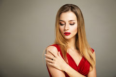 Beauty Portrait of Woman in Red on Gray Backgound Stock Photos