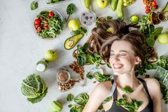 Portrait of a beautiful woman with healthy food royalty free stock photos