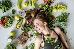 Portrait of a beautiful woman with healthy food royalty free stock images
