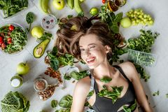 Portrait of a beautiful woman with healthy food stock photo
