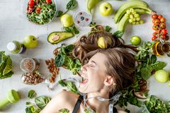 Portrait of a beautiful woman with healthy food royalty free stock photography