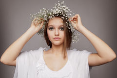 Beauty portrait with wreath of flowers Royalty Free Stock Photo
