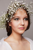Beauty portrait with wreath of flowers Royalty Free Stock Image