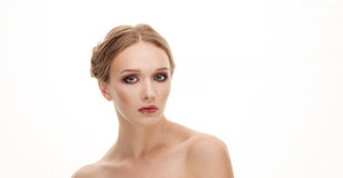 Beauty portrait of young adorable blonde woman with makeup and bare shoulders Stock Images