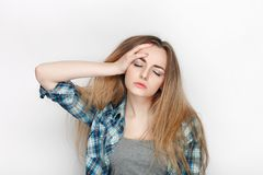 Beauty portrait of young adorable fresh looking blonde woman in blue plaid shirt. Emotion and facial expression concept. Royalty Free Stock Image